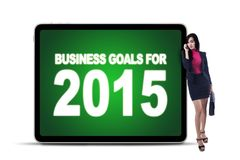 Businesswoman with business goals on the board Stock Images
