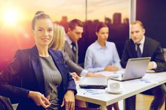 Businesswoman and business team at office royalty free stock photos