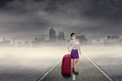 Businesswoman in the business trip 1. Business trip concept with a businesswoman standing on the road Royalty Free Stock Photo