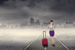 Businesswoman in the business trip 2. Business trip concept with a businesswoman standing on the road Royalty Free Stock Photos