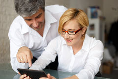 Businesswoman and businessman analyzing sales Stock Images