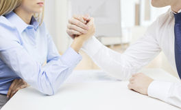 Businesswoman and businessman arm wrestling Royalty Free Stock Photos