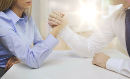 Businesswoman and businessman arm wrestling Royalty Free Stock Photo