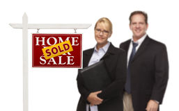 Businesswoman and Businessman Behind Real Estate Sign Isolated Stock Photos