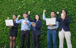 Businesswoman and businessman celebrating success of business pl stock image