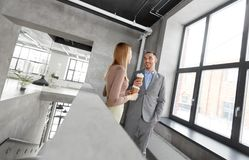 Businesswoman and businessman at coffee break stock photography