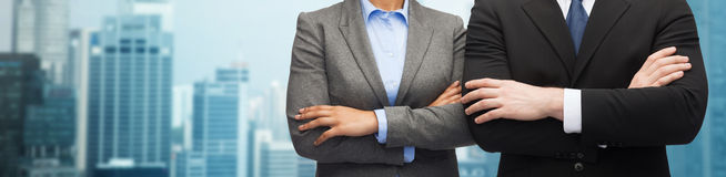 Businesswoman and businessman with crossed arms Royalty Free Stock Photography