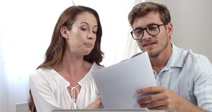 Businesswoman and businessman disagreeing stock video footage