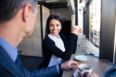 Businesswoman and businessman drinking coffee in cafe Royalty Free Stock Image