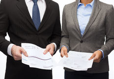 Businesswoman and businessman with files and forms. Business and economy concept - smiling businesswoman and businessman with files and forms stock photo