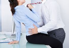 Businesswoman and businessman flirting Stock Photo