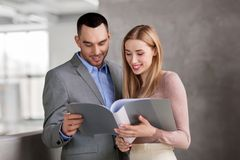 Businesswoman and businessman with folder Stock Image