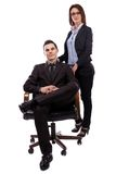 Businesswoman and businessman in full length pose Stock Photos