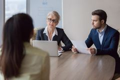 Businesswoman and businessman HR manager interviewing lady stock photos