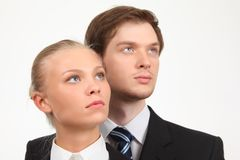 Businesswoman and businessman look upward Stock Photos