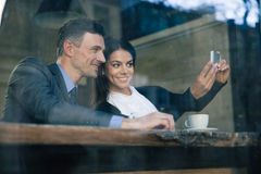 Businesswoman and businessman making selfie photo Stock Photo