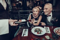 Businesswoman stops Waiter who pours Wine royalty free stock photography