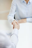 Businesswoman and businessman shaking hands Stock Photo