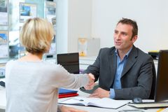 Businesswoman and businessman shaking hands royalty free stock photos