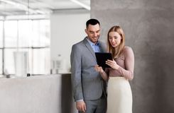 Businesswoman and businessman with tablet pc Stock Photography