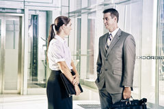 Businesswoman and Businessman talking Royalty Free Stock Photo