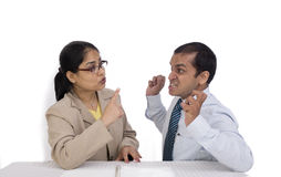 A businesswoman and a businessman talking aggressi Stock Photo