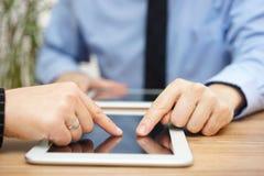 Businesswoman and businessman using digital tablet Stock Photos
