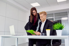 Businesswoman and businessman working at his desk in the office Stock Photography