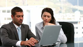 Businesswoman and a businessman working together. In a office stock footage