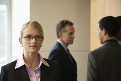 Businesswoman and Businessmen Stock Image