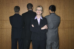 Businesswoman with Businessmen Royalty Free Stock Image