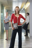 Businesswoman with Businesspeople in Background Stock Images
