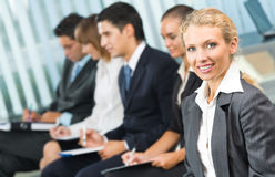 Businesswoman and businessteam Royalty Free Stock Photos