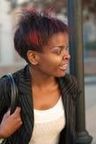 Businesswoman at bustop Stock Photos