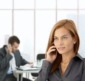 Businesswoman busy in office Royalty Free Stock Image