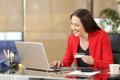 Businesswoman buying on line with credit card Stock Image
