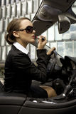 Businesswoman in a cabrio Stock Photography