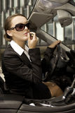 Businesswoman in a cabrio Stock Photo