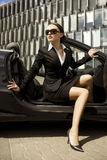 Businesswoman in a cabrio Stock Images