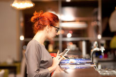 Businesswoman in a cafe Stock Image