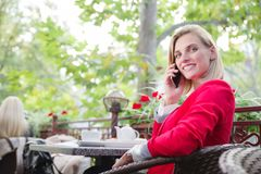 The businesswoman at the cafe ordered dessert and drinks tea royalty free stock images