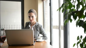 Businesswoman in a cafe stock footage