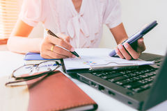 Businesswoman calculate about cost and doing finance at home office, Finance managers task,Concept business and finance investment. Businesswoman calculate about royalty free stock image