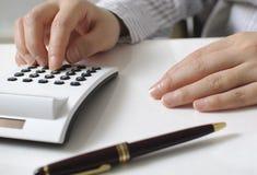 Businesswoman calculating expenses Stock Photos