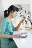Businesswoman Calculating Expenses With Calculator Stock Images