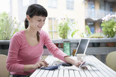 Businesswoman Calculating Expenses With Calculator Royalty Free Stock Photography