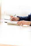 Businesswoman Calculating Sales Using Calculator Stock Photos