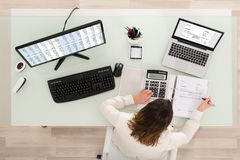 Businesswoman Calculating Tax Stock Image