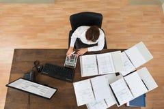 Businesswoman Calculating Tax stock photo