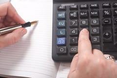 Businesswoman. Calculator Stock Photo